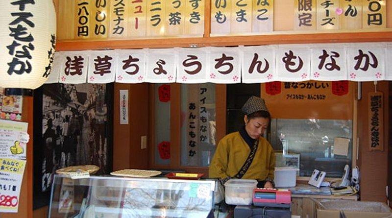Woman working in Tokyo, Japan market.