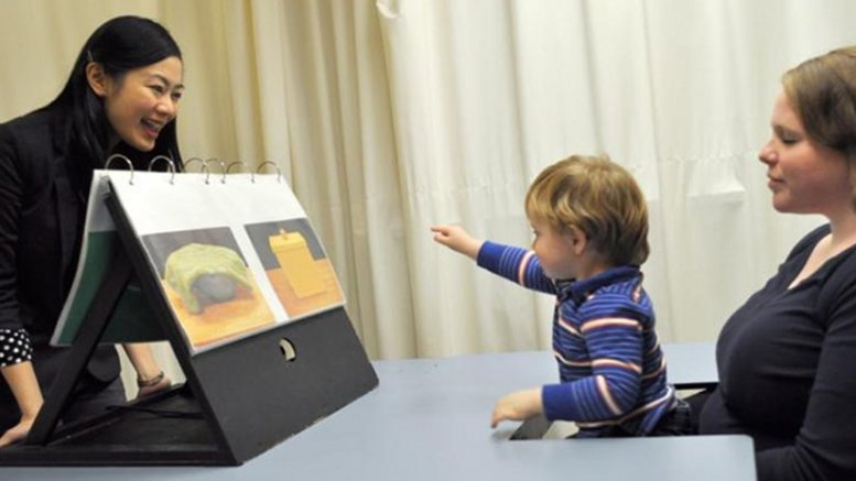 A child reacting to a question posed by NTU Assistant Professor Setoh Pei Pei (left) in a study that showed that the cognitive abilities of two-and-a-half-year-olds are more advanced than previously thought. Credit NTU Singapore