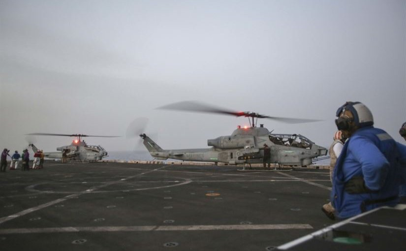 Two U.S. Marine Corps AH-1W Super Cobras assigned to the 22nd Marine Expeditionary Unit prepare for flight aboard the amphibious transport dock ship USS San Antonio in the Mediterranean Sea in support of Operation Odyssey Lightning, Nov. 8, 2016. It's an ongoing operation at the request of the Libyan Government of National Accord, the United States military conducted precision airstrikes against Islamic State of Iraq and the Levant targets in Sirte, Libya, to support GNA-affiliated forces seeking to defeat ISIL in its primary stronghold in Libya. Marine Corps photo by Sgt. Ryan Young