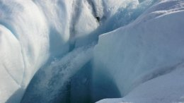 Meltwater from the Greenland ice sheet can travel through channels in the ice to reach bedrock; a new study show where subglacial water goes. Here, water plunges down a moulin, or hole in the ice. Credit Marco Tedesco/Lamont-Doherty Earth Observatory