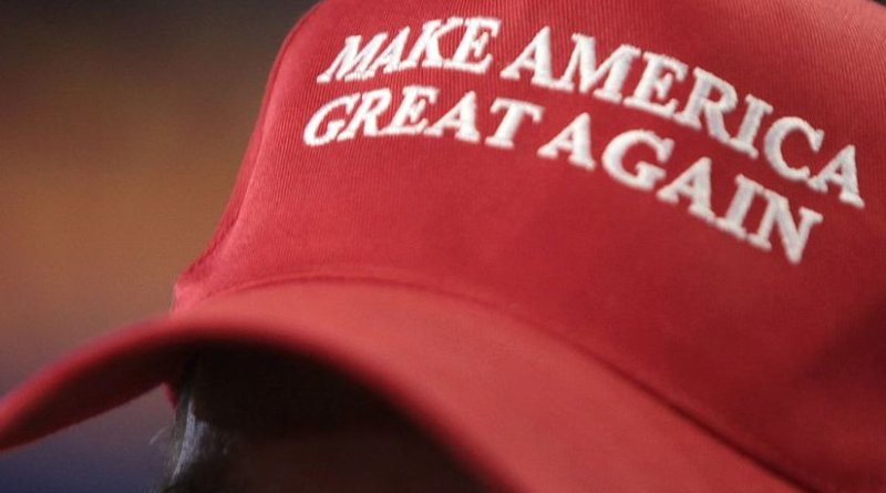 Make America Great Again hat in support of Donald Trump at a rally. Photo by Gage Skidmore, Wikipedia Commons.