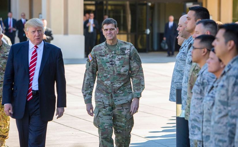 President Donald J. Trump and Army Gen. Joseph L. Votel, commander of U.S. Central Command, spend a few minutes with troops on their way to today's press briefing at MacDill Air Force Base, Fla., Feb. 6, 2017. President Trump visited Centcom headquarters to discuss issues relevant to the command's area of responsibility. U.S. Central Command photo by Marine Corps Sgt. Alan Belser