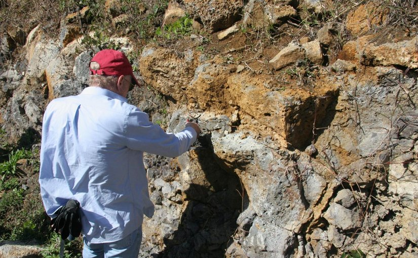This is lead author Prof. Lewis D. Ashwal studying an outcropping of trachyte rocks in Mauritius. Such samples are about 6 million years old, but surprisingly contain zircon grains as old as 3000 million years. Credit Susan Webb/Wits University
