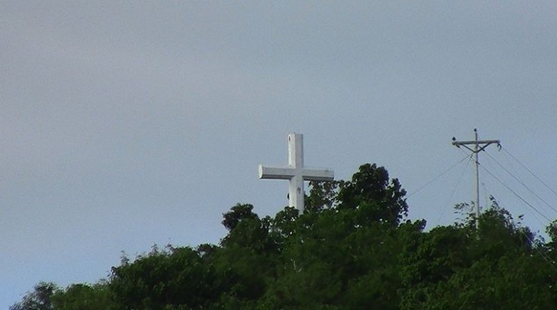The giant cross atop Guinhangdan Hill, Palo, Philippines, a favorite destination of Holy Week pilgrims. Photo by Bagoto, Wikipedia Commons.