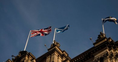 Flags of Scotland and United Kingdom flying in Edinburgh.