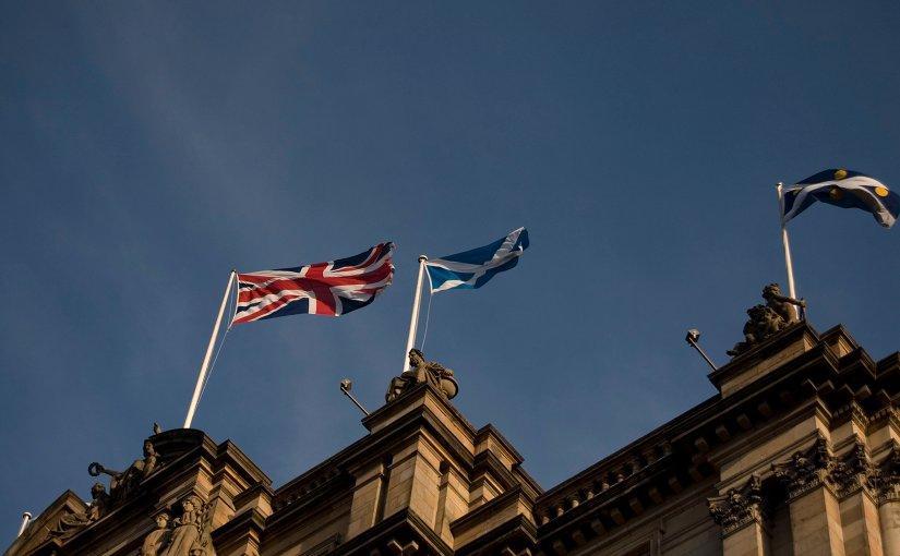 Flags of Scotland and United Kingdom flying in Edinburgh.