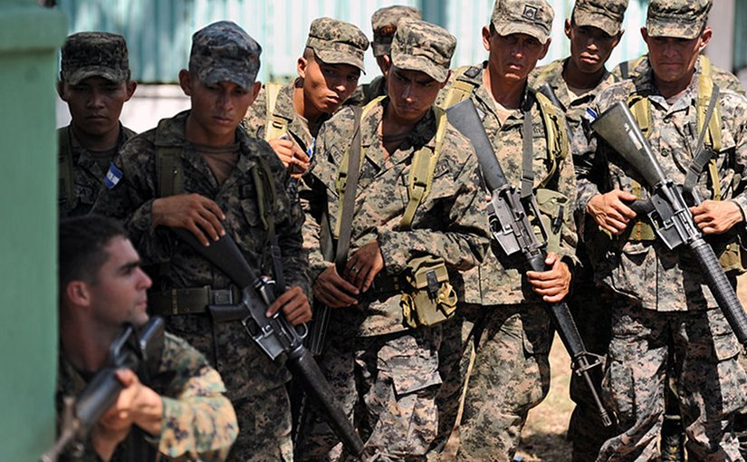 U.S. Marine Staff Sgt. Daniel Monteiro, lower left, assigned to Marine Corps Training and Advisory Group, demonstrates proper tactical movement to soldiers assigned to 11th Honduran Army Battalion. U.S. Navy photo by Mass Communication Specialist 2nd Class Ricardo J. Reyes, Wikimedia Commons.