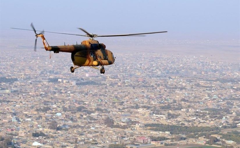 An Afghan National Army Mi-17 helicopter flies over the northern Afghan city of Mazar-e Sharif following a supply mission to an outpost at Qush Tappeh, Afghanistan, Nov. 13, 2010. Navy photo by Petty Officer 1st Class Eric S. Dehm