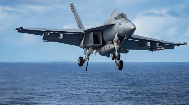 """An F/A-18E Super Hornet assigned to the """"Kestrels"""" of Strike Fighter Squadron (VFA) 137 prepares to make an arrested landing aboard the aircraft carrier USS Carl Vinson (CVN 70). The ship's carrier strike group is on a western Pacific deployment as part of the U.S. Pacific Fleet-led initiative to extend the command and control functions of U.S. 3rd Fleet. (U.S. Navy photo by Mass Communication Specialist 2nd Class Sean M. Castellano/Released)"""