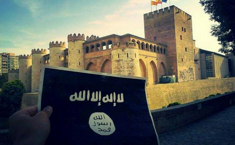 A photo that was tweeted by an Islamic State supporter holding the IS black flag of jihad in front of Aljafería Palace in Zaragoza, Spain.
