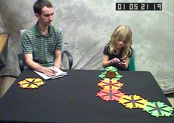 A 6-year-old girl follows instructions on a smartphone to program a turtle robot. Credit UW Institute for Learning & Brain Sciences