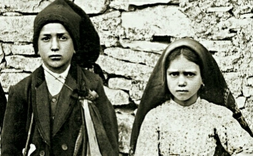 "Jacinta and Francisco Marto, the three children whom the Virgin Mary revealed her famous ""three secrets"" in Fátima, Portugal. Photo credit: Joshua Benoliel, Wikipedia Commons."