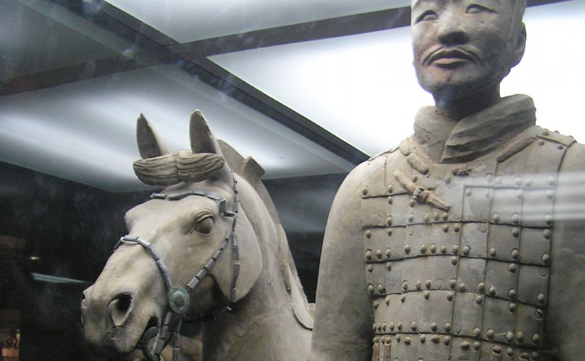 A terracotta soldier with his horse. Photo by Robin Chen, Wikipedia Commons.