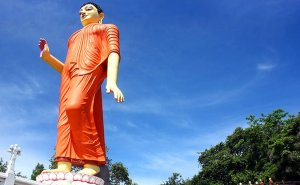 80-foot World's tallest statue of walking Buddha in Pilimathalawa, Kandy, Sri Lanka. Photo by AntanO, Wikipedia Commons.
