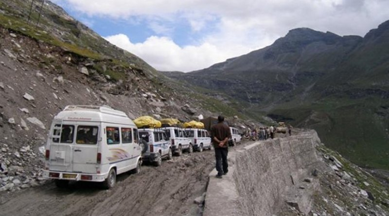 Trucks line up for their turn to climb a mountain pass on India's Manali-Leh Highway. Credit Brooke Crowley