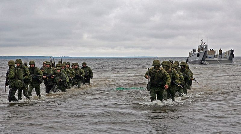 Estonian soldiers wade ashore during a combined U.S. and Estonia amphibious assault training exercise during Baltic Operations (BALTOPS) 2010. U.S. Marine Corps photo by Sgt. Rocco DeFilippis.