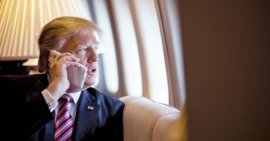 US President Donald Trump on board Air Force One. (Photo by Shealah Craighead, White House).