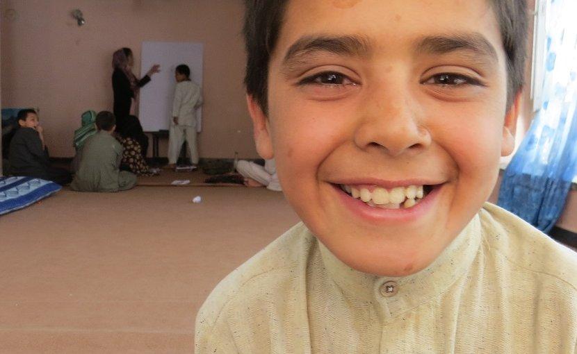10-year-old Afghan Street Kid Mubasir smiles despite his difficulties.