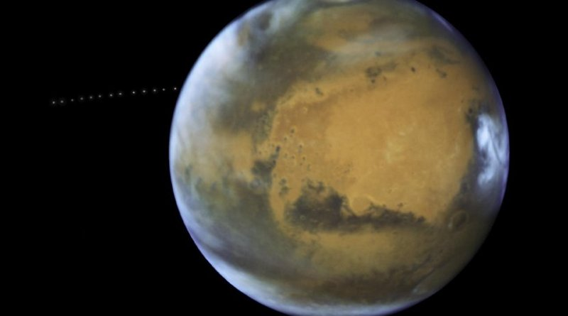 Over the course of 22 minutes, Hubble took 13 separate exposures, allowing astronomers to create a time-lapse image showing the tiny moon Phobos during its orbital trek (white dots) around Mars. This image is a composite of separate exposures acquired by NASA's Hubble WFC3/UVIS instrument.