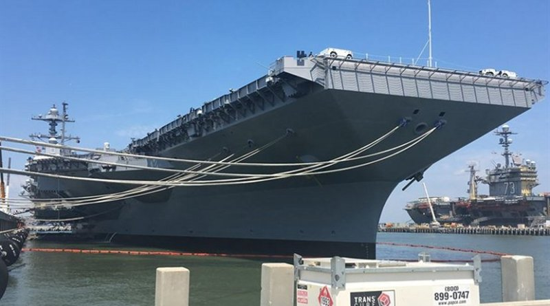 The aircraft carrier Gerald R. Ford is docked at Pier 11, Naval Station Norfolk, Va., June 30, 2017. The ship was undergoing preparations for its commissioning ceremony. The aircraft carrier USS George Washington is at background right. DoD photo by Thomas M. Ruyle
