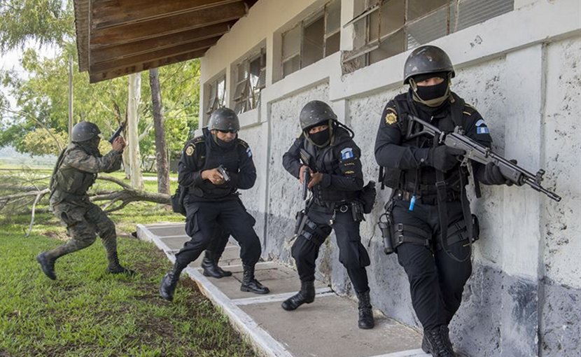 Police and soldiers in Guatemala prepare to enter a building during a U.S. Army-supported evaluation exercise to train the Guatemalan forces to be better prepared to combat illegal drug trafficking operations, Jupiata, Guatemala. Air Force photo by Tech. Sgt. Trevor Tiernan