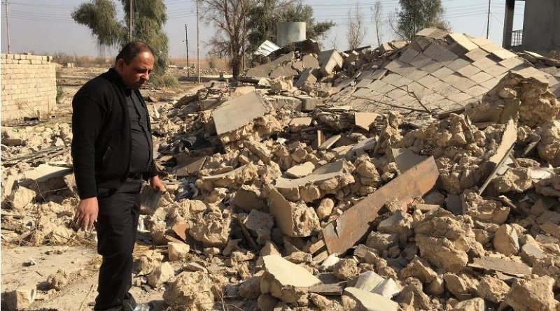 A Catholic church ruined by ISIS in Karamdes, Iraq, is examined by a priest following the predominately Christian town's liberation. Photo Credit: Knights of Columbus.