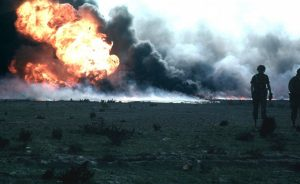 More than 600 Kuwaiti oil wells were set on fire by retreating Iraqi forces, causing massive environmental and economic damage to Kuwait. Photo by Jonas Jordan, United States Army Corps of Engineers, Wikipedia Commons.