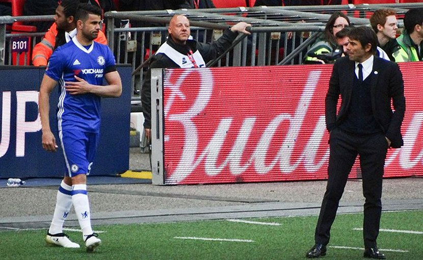 Antonio Conte with Diego Costa during the 2017 FA Cup Semi final against Tottenham. Photo Credit: @cfcunofficial (Chelsea Debs) London, Wikipedia Commons.