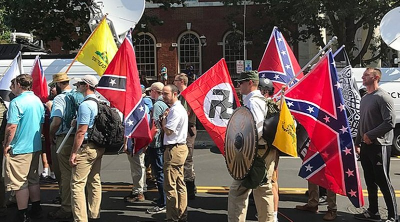 Protesters at Charlottesville, Virginia rally carrying Confederate flags, Gadsden flags and a Nazi Flag. Photo byAnthony Crider, Wikipedia Commons.