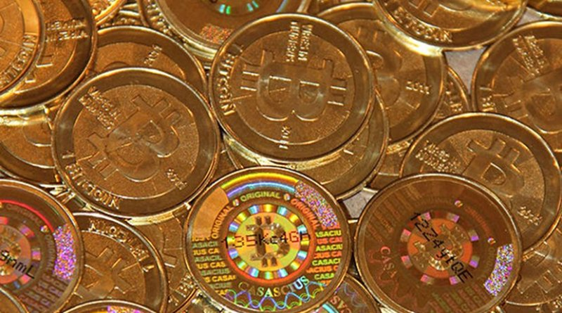 Bitcoins. Photo by Mike Cauldwell, Wikimedia Commons.