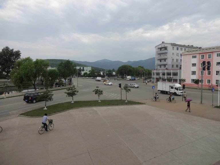 "Street crossing in front of our hotel ""Rajin"""