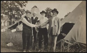 Civil War Union and Confederate veterans shake hands at encampment, ca. 1910-1920. (Source: Liljenquist Family collection, Library of Congress Prints and Photographs Division)
