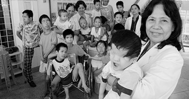 Ho Chi Minh. Professor Nguyen Thi Ngoc Phuong, at Tu Du Obstetrics and Gynecology Hospital is pictured with a group of handicapped children, most of them victims of Agent Orange. Photo by Alexis Duclos, Wikipedia Commons.