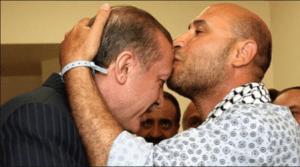 Mahdi al-Harati kissing President Erdogan