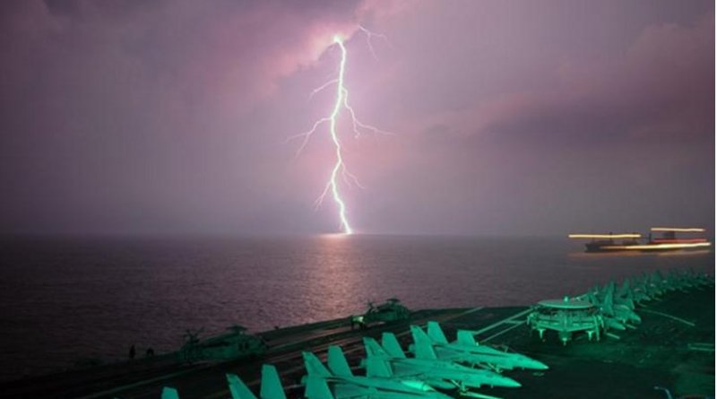 This is lightning behind an aircraft carrier in the Strait of Malacca. Credit: pxhere.com