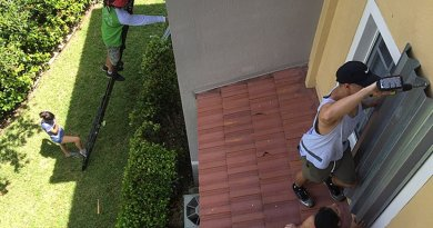 Residents in Doral, Florida installing hurricane shutters in advance of Hurricane Irma. Photo by Cyclonebiskit, Wikipedia Commons.