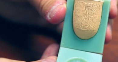 MSU's biometrics expert Anil Jain and his Ph.D. student Joshua Engelsma have, for the first time, designed and created a fake finger containing multiple key properties of the human skin. Commonly called a spoof, this fake finger is being used to test fingerprint readers to help determine their resilience to spoof attacks and which will lead to more resilient fingerprint readers. Credit Michigan State University