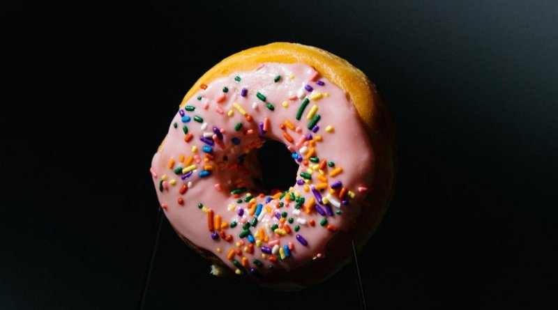 """""""Imagine you are holding a doughnut in the dark,"""" Emory University mathematician Ken Ono says. """"You wouldn't even be able to decide whether it has any sprinkles. But the information in our O'Nan moonshine allows us to 'see' our mathematical doughnuts clearly by giving us a wealth of information about the points on elliptic curves."""" Credit Photo by Stephen Nowland, Emory University"""