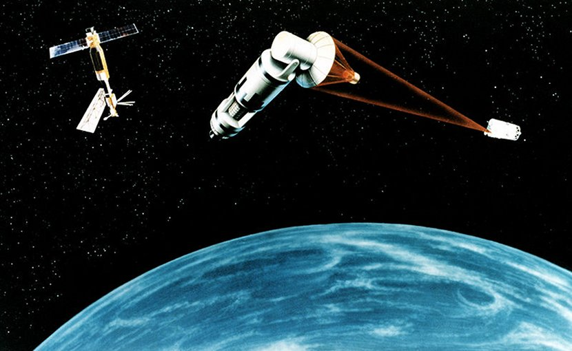 1984 artist's concept of a generic laser-equipped satellite firing on another with the proposed Space Station Freedom(ISS) in the background. Source: U.S. Air Force, Wikipedia Commons.