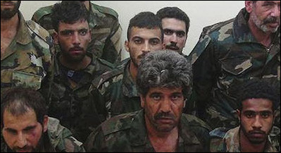 Syrian government soldiers captured by the Islamic State. The battles in Iraq and Syria are wars of annihilation where quarter is rarely given and where most prisoners of war are eventually killed. ISIS has also been vocal about genocidal intentions toward Shiite Muslims and Alawites.