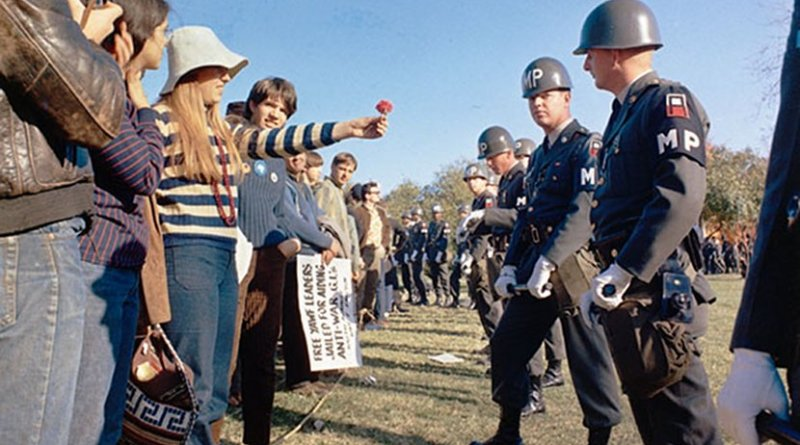 A female demonstrator offers a flower to military police on guard at the Pentagon during an anti-Vietnam demonstration. Arlington, Virginia, USA. Photo by S.Sgt. Albert R. Simpson. Department of Defense, Wikipedia Commons.