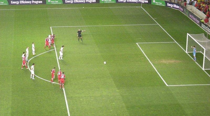 Player preparing to take a penalty kick. Photo by Michael Barera, Wikipedia Commons.
