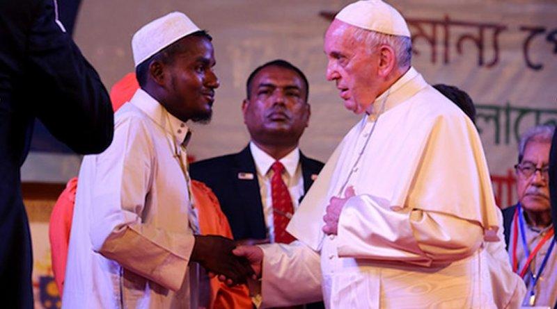 Pope Francis speaks with Muhammad Nurullah, a Rohingya refugee from Myanmar's Rakhine State, during a meeting in Dhaka on Dec. 1. Photo by Joe Torres, Ucanews.com