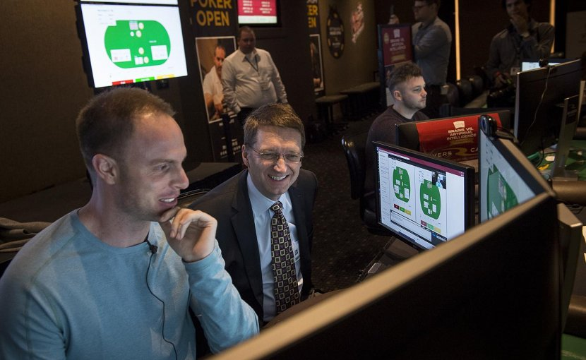 Jason Les, a professional poker player specializing in heads-up, no-limit Texas Hold'em, is watched by Tuomas Sandholm, professor of computer science at Carnegie Mellon University, as play gets underway in the Brains Vs. AI competition in January 2017. Libratus, an AI developed at Carnegie Mellon, beat Les and three other pros during the 20-day competition in Pittsburgh. Credit Carnegie Mellon University