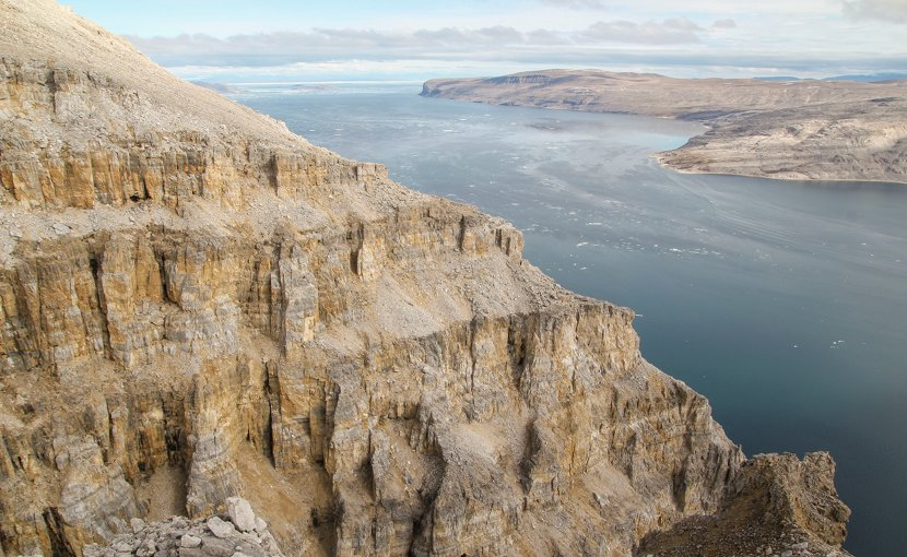 The Angmaat Formation above Tremblay Sound on the Baffin Island coast. Bangiomorpha pubescens fossils occur in this roughly 500-meter thick rock formation. CREDIT: Timothy Gibson