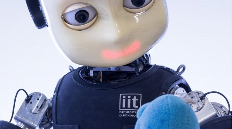 """iCub is a robot child whose project is coordinated by IIT-Istituto Italiano di Tecnologia. It is a standardized common open-source platform for research on embodied artificial intelligence (AI). iCub is able to crawl on all fours, sit-up, balance walk, interact physically with the environment and recognize objects. It is one of the few robots in the world with a sensitive full-body electronic skin system to provide the sense of """"touch"""". Credit IIT-Istituto Italiano di Tecnologia"""