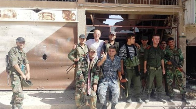 """2018 will likely present an intensification of the Syrian Civil War with rebels such as the gentleman shown above with the author, and scores of thousands more, vowing not to give up the fight with the foreign proxies until their country is """"liberated."""" Photo courtesy of Franklin Lamb."""
