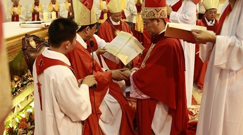 Excommunicated Huang Bingzhang of Shantou (kneeling) accepted an illegal bishop ordination on July 14, 2011, and was punished by the Holy See two days later. (Photo supplied via UCAN)