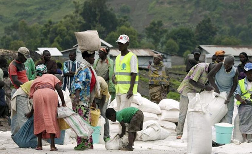 Residents of the camp of the Internally Displaced Persons (IDPs) receive food rations distributed by the World Food Programme (WFP) in collaboration with an international non-governmental organization, CARITAS. North Kivu, Democratic Republic of the Congo. Photo: Flickr/UN Photo/Marie Frechon