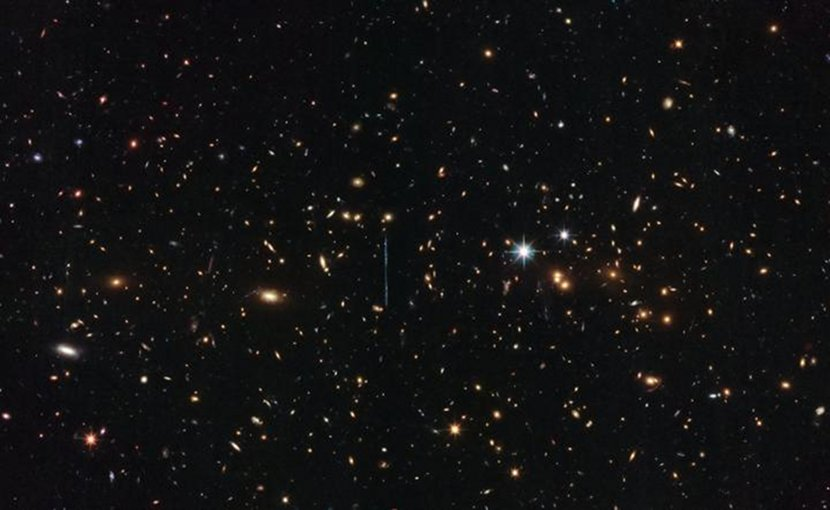 This image was taken by Hubble's Advanced Camera for Surveys and Wide-Field Camera 3 as part of an observing program called RELICS (Reionization Lensing Cluster Survey). RELICS imaged 41 massive galaxy clusters with the aim of finding the brightest distant galaxies for the forthcoming James Webb Space Telescope to study. Credit ESA/Hubble & NASA, RELICS